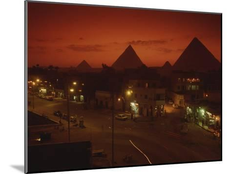 Nazlet El Samman, Town with Giza Pyramids, Sunset--Mounted Photographic Print