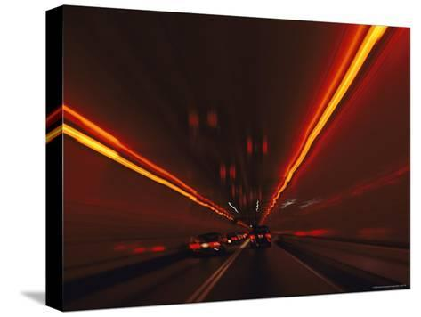 The Taillights of Cars Reflected on the Walls and Ceiling of a Tunnel-Medford Taylor-Stretched Canvas Print