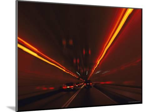 The Taillights of Cars Reflected on the Walls and Ceiling of a Tunnel-Medford Taylor-Mounted Photographic Print
