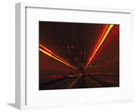 The Taillights of Cars Reflected on the Walls and Ceiling of a Tunnel-Medford Taylor-Framed Art Print