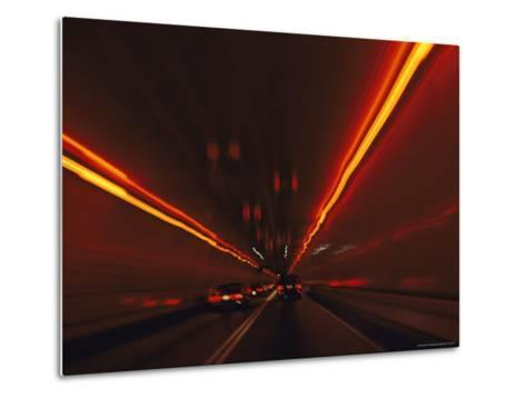 The Taillights of Cars Reflected on the Walls and Ceiling of a Tunnel-Medford Taylor-Metal Print