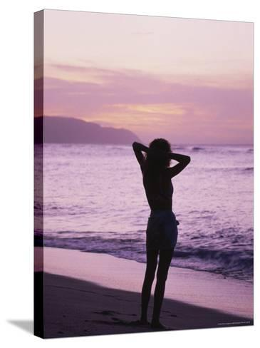 Woman Standing on Beach in Silhouette-Bill Romerhaus-Stretched Canvas Print