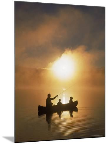 People Fishing from Canoe at Sunset-Bob Winsett-Mounted Photographic Print