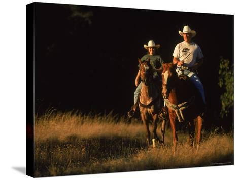 Couple Horseback Riding, Jack London State Park, CA-Robert Houser-Stretched Canvas Print
