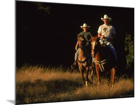 Couple Horseback Riding, Jack London State Park, CA-Robert Houser-Mounted Photographic Print