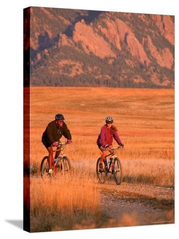 Couple Mountain Biking, CO-Chris Rogers-Stretched Canvas Print