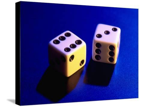 Two Dice on Blue Background-Jim McGuire-Stretched Canvas Print