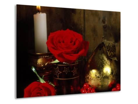 Lit White Candle in Gold Holder with Two Red Roses, Ilex Berries & Gold Pear Christmas Ornament-James Guilliam-Metal Print