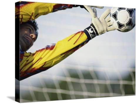 Goalie Attempting to Stop a Soccer Ball--Stretched Canvas Print