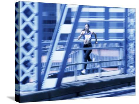 Young Woman Running--Stretched Canvas Print