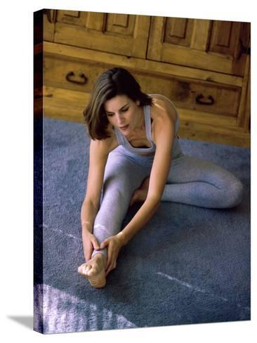 Young Woman Stretching on the Floor--Stretched Canvas Print
