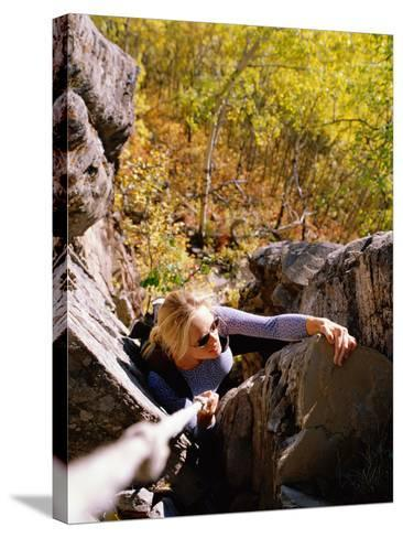 High Angle View of Young Woman Rock Climbing--Stretched Canvas Print