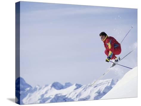 Male Skier Jumping--Stretched Canvas Print