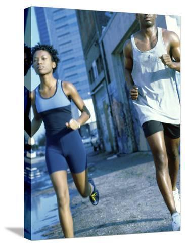 Young Couple Jogging Together--Stretched Canvas Print
