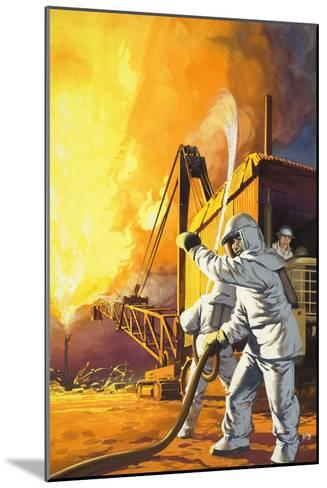 Fireman in Safety Suit Fighting a Fire at an Oil Field-Angus Mcbride-Mounted Giclee Print