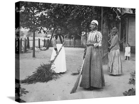 Female Servants Using Brooms of Bambusa on Latimer's Plantation, Belton, South Carolina, 1899--Stretched Canvas Print