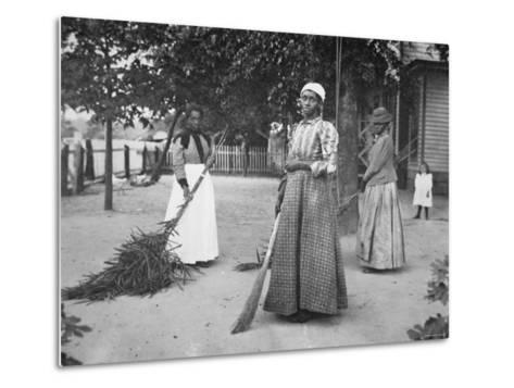 Female Servants Using Brooms of Bambusa on Latimer's Plantation, Belton, South Carolina, 1899--Metal Print