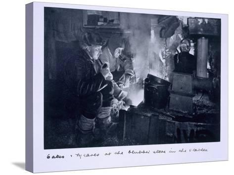 Oates and Meares at the Blubber Stove in the Stables, from Scott's Last Expedition-Herbert Ponting-Stretched Canvas Print