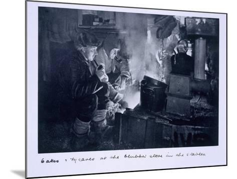 Oates and Meares at the Blubber Stove in the Stables, from Scott's Last Expedition-Herbert Ponting-Mounted Photographic Print