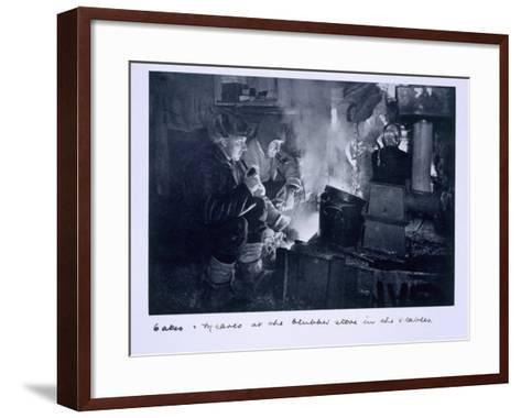 Oates and Meares at the Blubber Stove in the Stables, from Scott's Last Expedition-Herbert Ponting-Framed Art Print