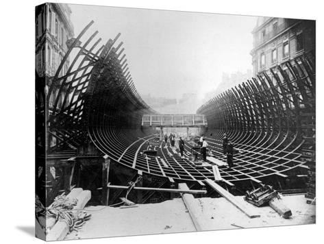 Paris Metro at Place Saint-Michel: Caisson Prior to Its Being Placed in the River Seine, c.1906--Stretched Canvas Print