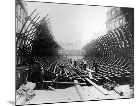 Paris Metro at Place Saint-Michel: Caisson Prior to Its Being Placed in the River Seine, c.1906--Mounted Photographic Print