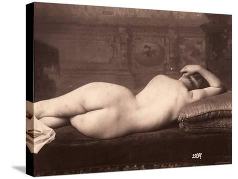Portrait of a Nude Woman Lying on a Couch with Her Back to the Camera--Stretched Canvas Print