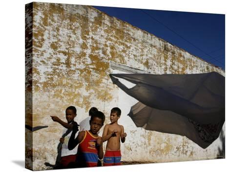 A Group of Children Fly Plastic Bags, Known as Papalotes-Javier Galeano-Stretched Canvas Print