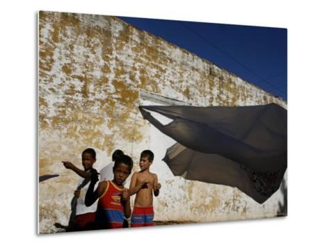 A Group of Children Fly Plastic Bags, Known as Papalotes-Javier Galeano-Metal Print