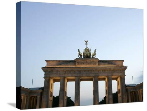 The Brandenburg Gate Glows in the Evening Light in Berlin--Stretched Canvas Print