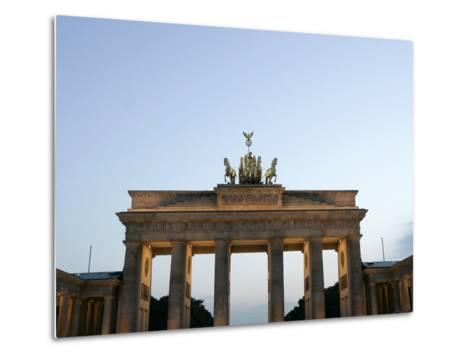 The Brandenburg Gate Glows in the Evening Light in Berlin--Metal Print