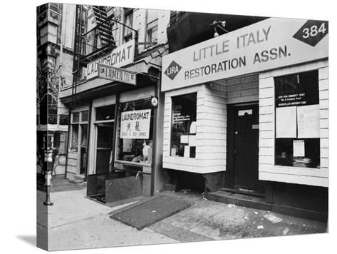 A Chinese Laundromat is Seen Next Door to the Offices of the Little Italy Restoration Association--Stretched Canvas Print