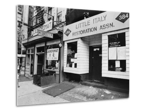 A Chinese Laundromat is Seen Next Door to the Offices of the Little Italy Restoration Association--Metal Print