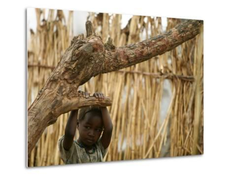 A Sudanese Girl Plays Inside a Thatched Hut at the Refugee Camp of Zamzam--Metal Print