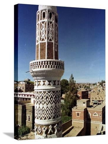 The Minaret of a 15th Century Mosque Rises Above a San'a, Yemen Neighborhood--Stretched Canvas Print