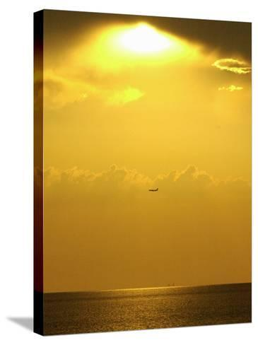 At Sunset a Commerical Jet Makes its Approach to Louis Armstrong New Orleans International Airport--Stretched Canvas Print