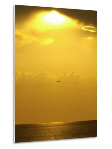 At Sunset a Commerical Jet Makes its Approach to Louis Armstrong New Orleans International Airport--Metal Print