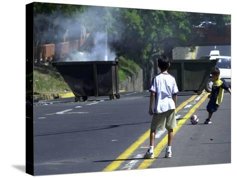Two Children Take Advantage of a Blockade--Stretched Canvas Print