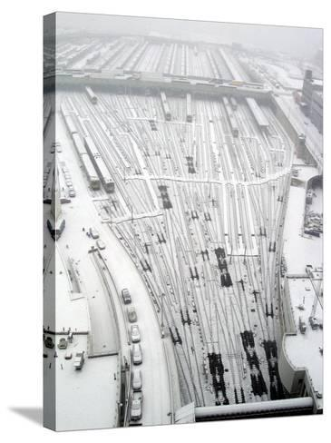 Snow Covers the Railroad Tracks at the Westside Railyard as Snow Falls on New York--Stretched Canvas Print