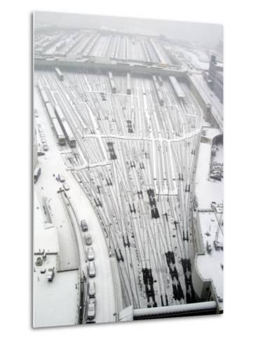 Snow Covers the Railroad Tracks at the Westside Railyard as Snow Falls on New York--Metal Print