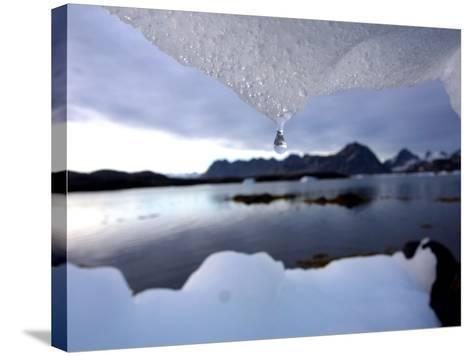 An Iceberg Melts in Kulusuk, Greenland--Stretched Canvas Print