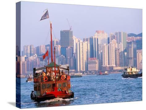 Tourist Boat in Hong Kong Harbor, Hong Kong, China-Paul Souders-Stretched Canvas Print