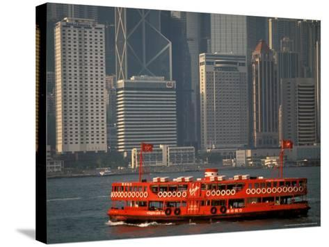 Star Ferry in Hong Kong Harbor, Hong Kong, China-Walter Bibikow-Stretched Canvas Print