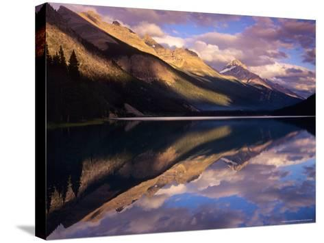Reflection of Clouds and Mountains on Waterfoul Lake, Banff National Park, Alberta, Canada-Janis Miglavs-Stretched Canvas Print