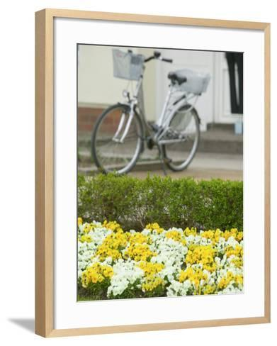 Flowers and Bicycle, Warnemunde, Germany-Russell Young-Framed Art Print