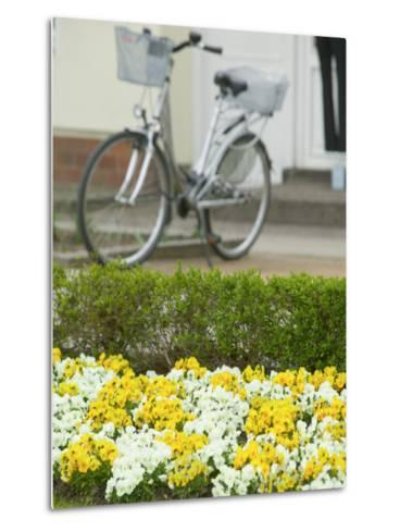 Flowers and Bicycle, Warnemunde, Germany-Russell Young-Metal Print