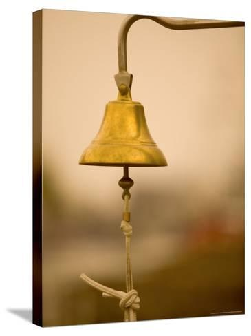 Ship's Bell, Warnemunde, Germany-Russell Young-Stretched Canvas Print