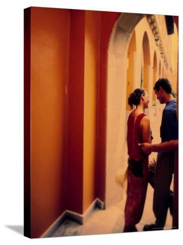 Spanish Couple Outside of Hotel Muncey, Tenerife, Canary Islands, Spain-Stuart Westmoreland-Stretched Canvas Print