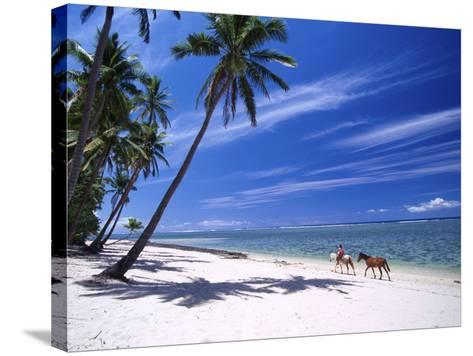 Girl on Beach with Coconut Palm Trees, Tambua Sands Resort, Coral Coast, Fiji-David Wall-Stretched Canvas Print