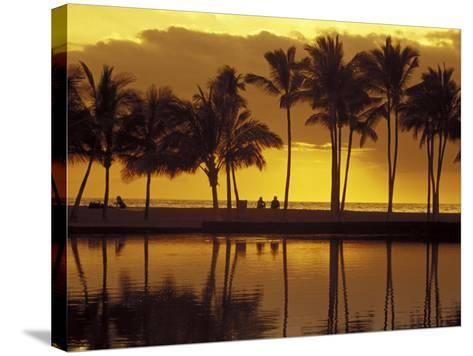 Couple, Palm Trees and Sunset Reflecting in Lagoon at Anaeho'omalu Bay, Big Island, Hawaii, USA-John & Lisa Merrill-Stretched Canvas Print